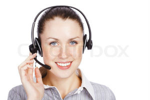 Lady with telephone headset on and smiling